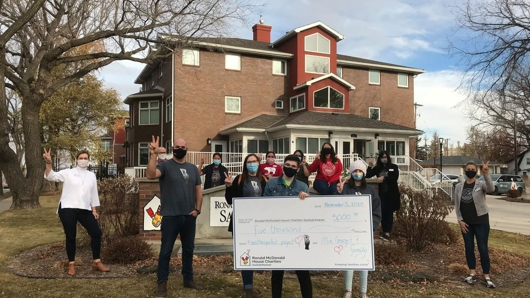 Mia Georget and family present cheque at RMHC Saskatchewan