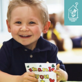 Child smiling, happy meal donation image