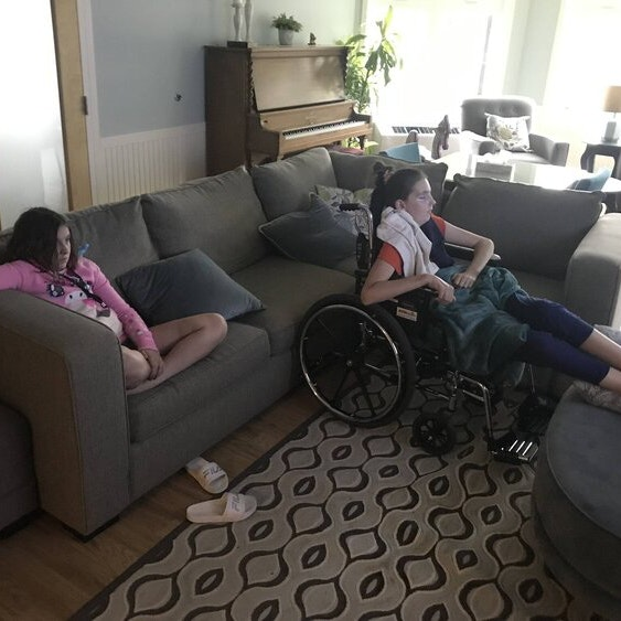 Mia and Macey on couch at RMHC Saskatchewan